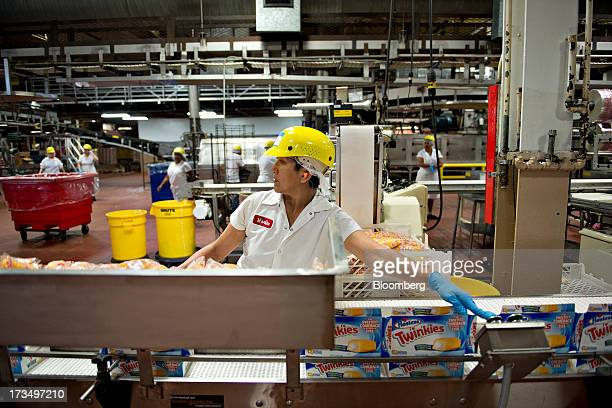 A bakery employee works on the packing line of Twinkies snack cakes at a Hostess Brands LLC bakery in Schiller Park Illinois US on Monday July 15...