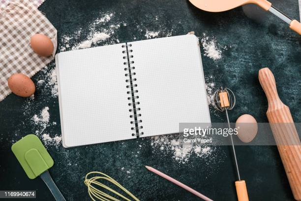 bakery ingredients and open notebook - kitchen background stock pictures, royalty-free photos & images