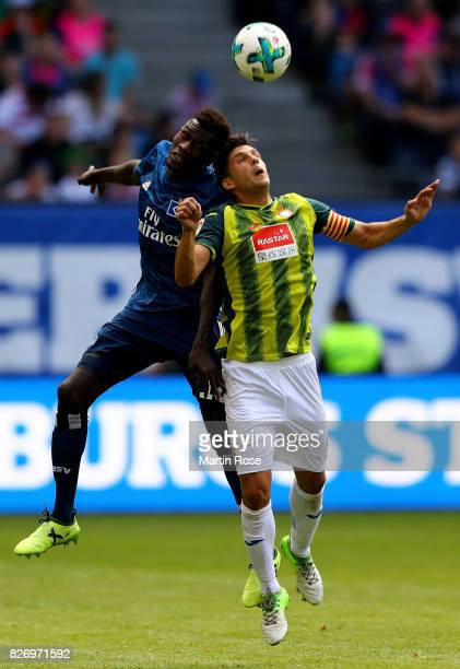 Bakery Jatta of Hamburg and Javier Lopez of RCD Espanyol jumo to head for the ball during the preseason friendly match between Hamburger SV and RCD...