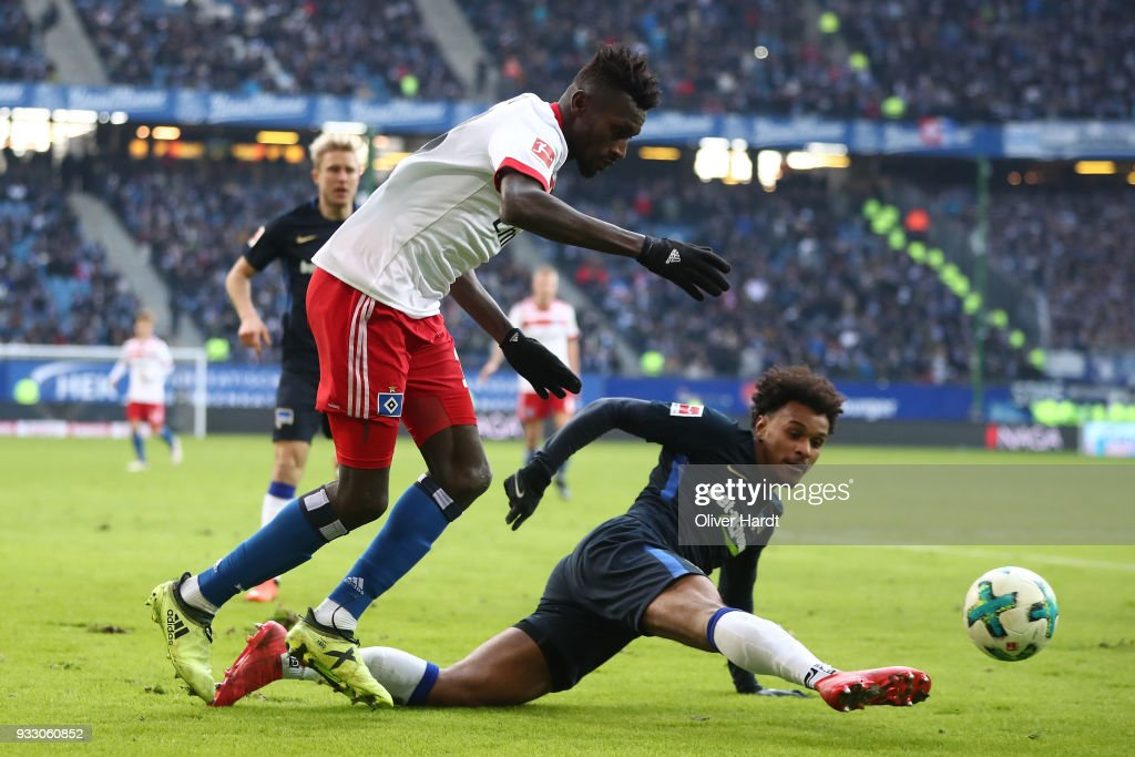 Bakery Jatta (L) of Hamburg and Valentino Lazaro (R) of Berlin compete for the ball during the Bundesliga match between Hamburger SV and Hertha BSC at Volksparkstadion on March 17, 2018 in Hamburg, Germany.