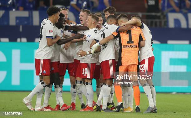 Bakery Jatta of Hamburg celebrates with team mates after scoring his teams third goal during the Second Bundesliga match between FC Schalke 04 and...
