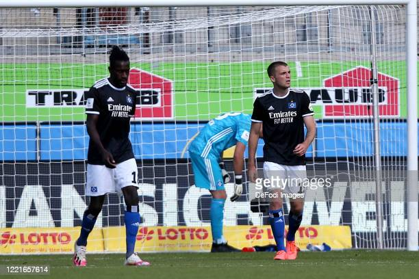 Bakery Jatta of Hamburger SV and Louis Beyer of Hamburger SV looks dejected during the Second Bundesliga match between 1. FC Heidenheim 1846 and...
