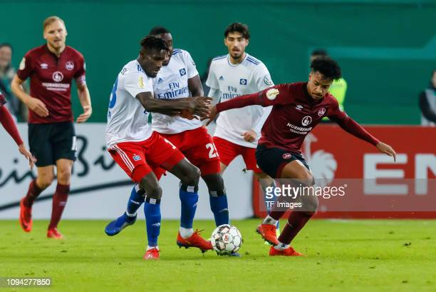 Bakery Jatta of Hamburger SV Orel Mangala of Hamburger SV and Matheus Pereira of 1 FC Nuernberg battle for the ball during the DFB Cup match between...