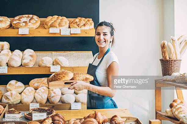 Bakery owner at the bread display
