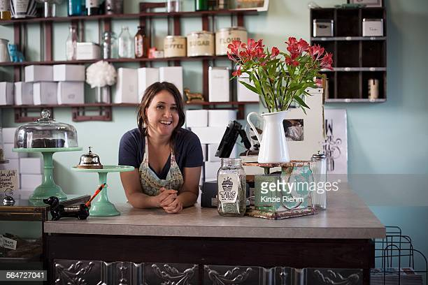 Bakery owner leaning over counter