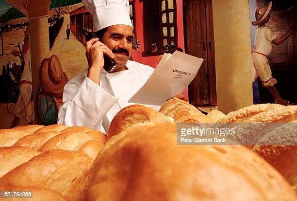 bakery owner using telephone - pamphlet stock pictures, royalty-free photos & images