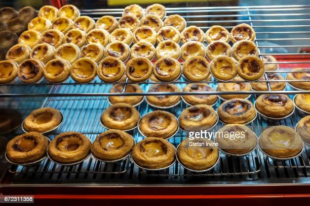 A bakery selling Portuguesestyle custard egg tarts at the Raohe Street Night Market in Taipei where many tourists and locals can enjoy an enormous...