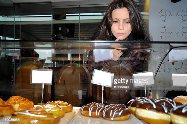 Bakery: Woman Thinking About Doughnuts