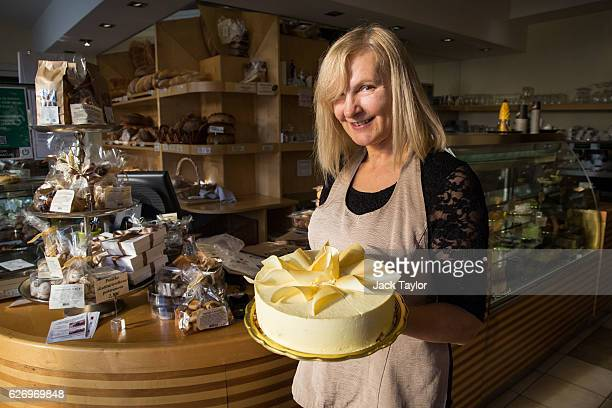 Bakery worker Jelenc Darja is pictured holding a white chocolate mousse cake with gold decoration called 'Melanija' created in honour of Melania...