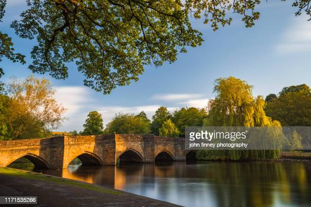 bakewell bridge. historical landmark in bakewell, england - valley stock pictures, royalty-free photos & images