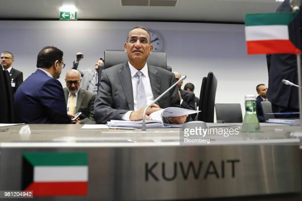 Bakheet AlRashidi Kuwait's oil minister browses documents ahead of the 174th Organization Of Petroleum Exporting Countries meeting in Vienna Austria...