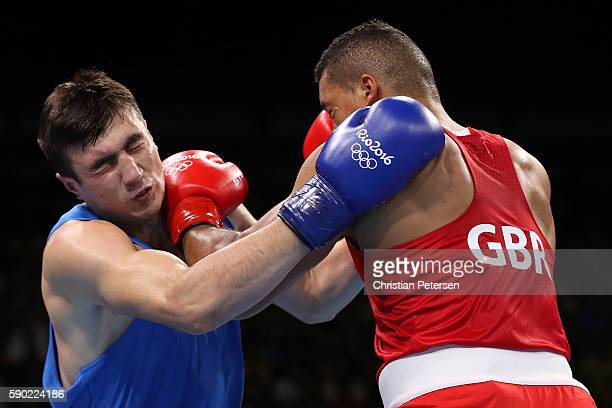 Bakhodir Jalolov of Uzbekistan fights against Joe Joyce of Great Britain during the Men's Super Heavy Quarterfinal 3 on Day 11 of the Rio 2016...