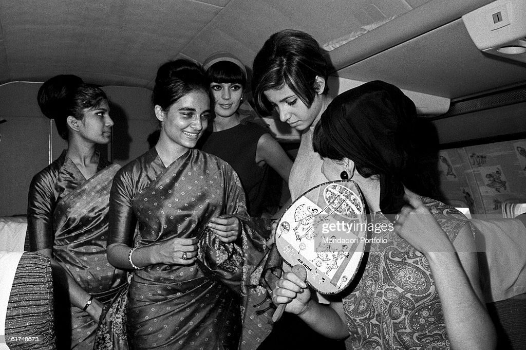 Some models get familiar with Indian hostesses in the aircraft cabin : News Photo
