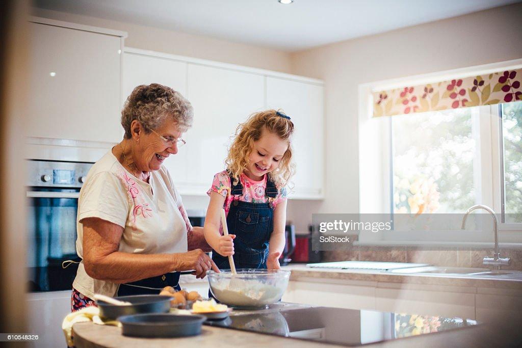 Baking a Cake with Grandma : Stock Photo