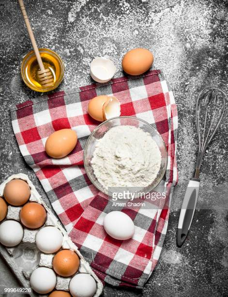 Baking background. Flour and fresh eggs for baking on rustic background .