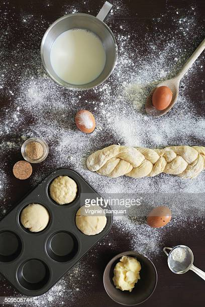 Baking brioche vendéenne, with ingredients on a dark wooden table