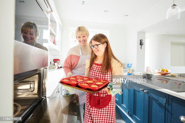 baking cakes - learning disability stock pictures, royalty-free photos & images
