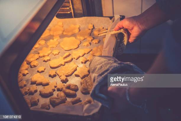 baking christmas cookies oven close up - gingerbread cookie stock pictures, royalty-free photos & images