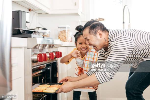 baking cookies with dad - mixed race person stock pictures, royalty-free photos & images