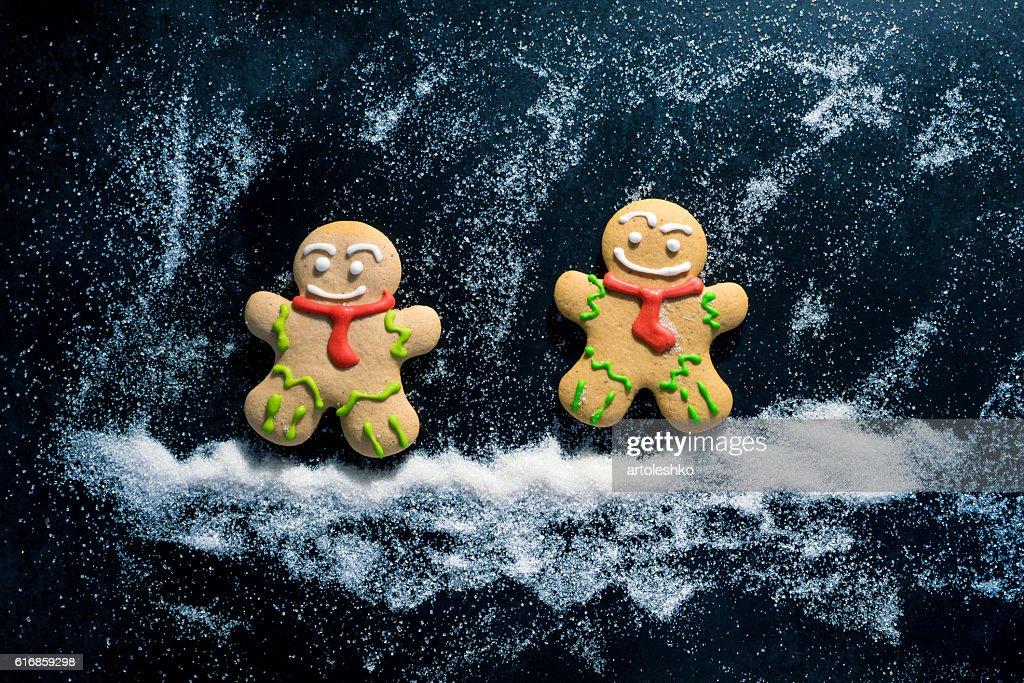 Baking Gingerbread Men for Christmas on dark table : Stock Photo
