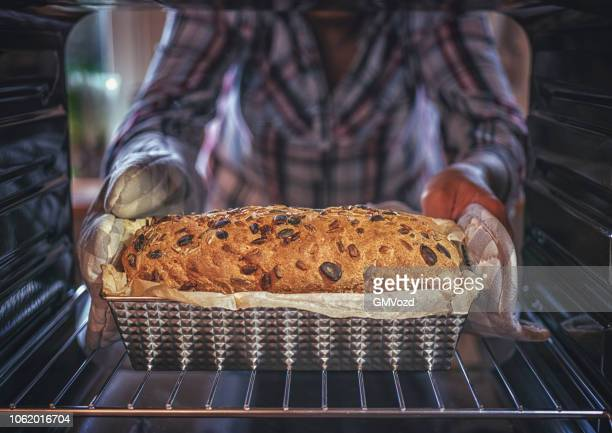 baking healthy seed bread in the oven - oven stock pictures, royalty-free photos & images