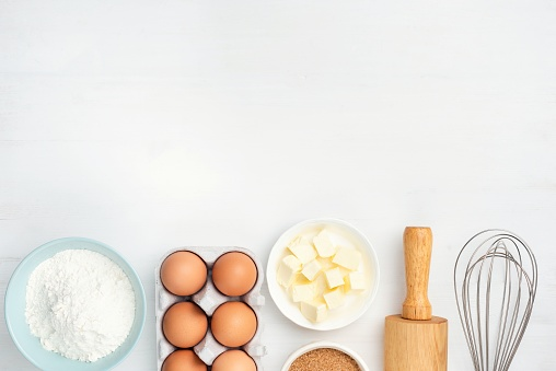 Baking ingredients and kitchen utensils on white background 1135036976