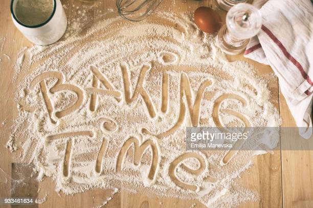 Baking ingredients and white flour on wooden table