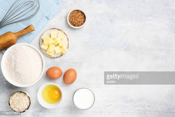 baking ingredients eggs flour butter sugar - butter stock pictures, royalty-free photos & images