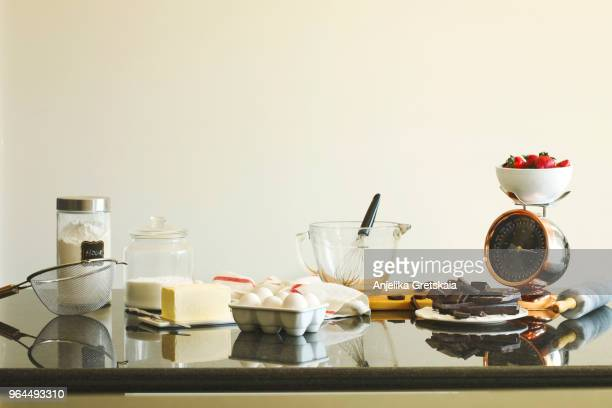 baking ingredients for making chocolate cake. - cooking utensil stock pictures, royalty-free photos & images
