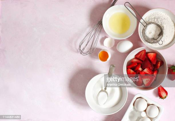 baking ingredients for making strawberry cake or pie - berry stock pictures, royalty-free photos & images