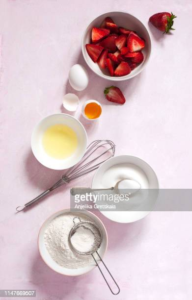 baking ingredients for making strawberry cake or pie - egg white stock pictures, royalty-free photos & images