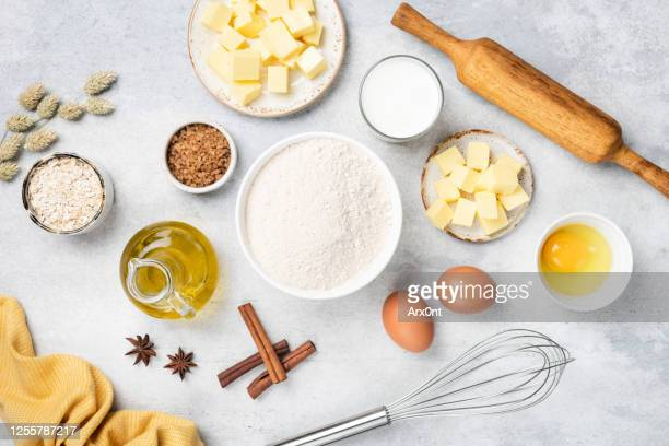 baking ingredients on white concrete background - ingredient stock pictures, royalty-free photos & images