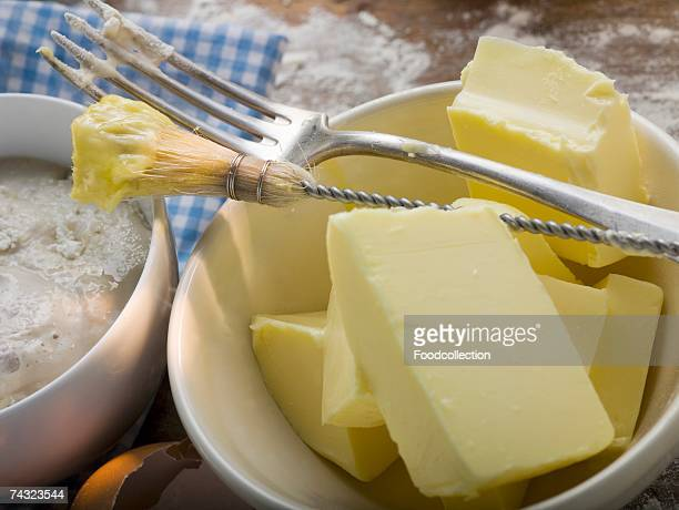 baking ingredients (butter, yeast), pastry brush, fork - basting brush stock photos and pictures