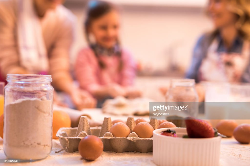 Baking ingredients with people in the background! : Stock Photo