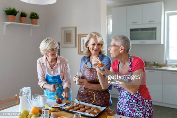 baking is our favorite thing - three people stock pictures, royalty-free photos & images