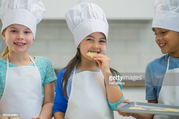 baking on a field trip - primary age child stock pictures, royalty-free photos & images