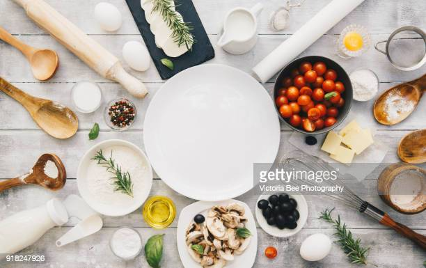 Baking preparation background. Freshly baked pizza. Cooking process, Italian food concept