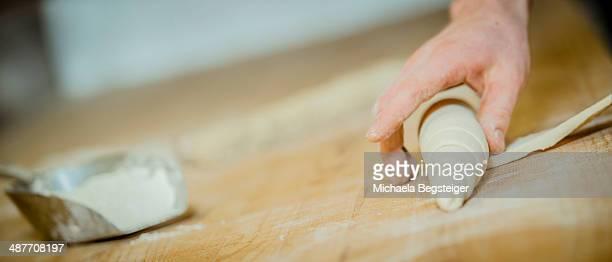 Baking rolls, hand shaping dough