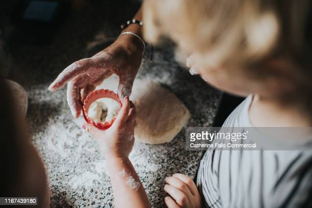 baking scones - mother stock pictures, royalty-free photos & images