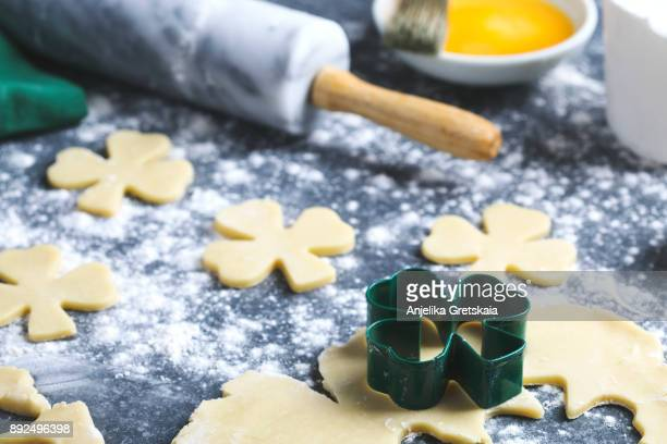 baking st. patrick's day cookies. - st patricks background stock pictures, royalty-free photos & images