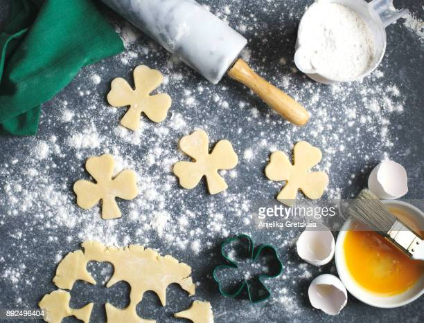 baking st. patrick's day cookies - st patricks stock pictures, royalty-free photos & images