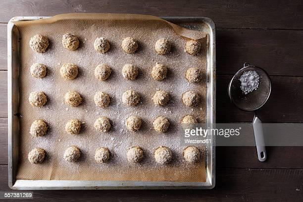 Baking tray of flapjacks sprinkled with icing sugar