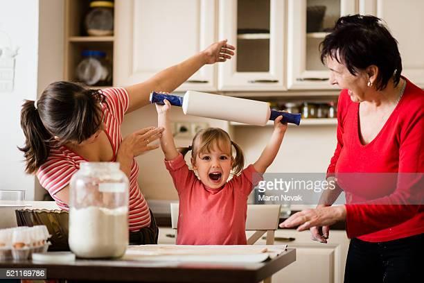 Baking winner - family preparing cookies