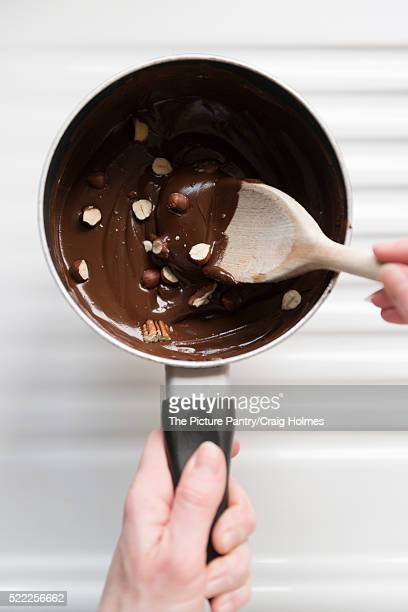 Baking with melted chocolate and nut sauce in a saucepan.