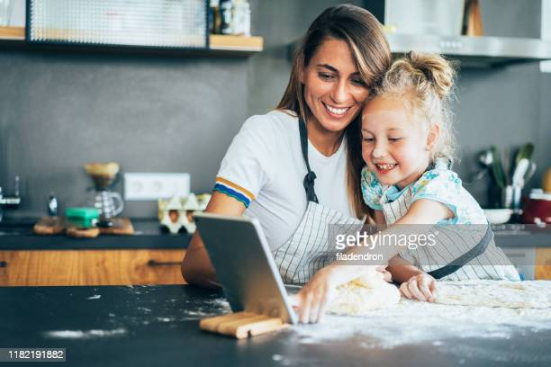 baking with mom - baking stock pictures, royalty-free photos & images
