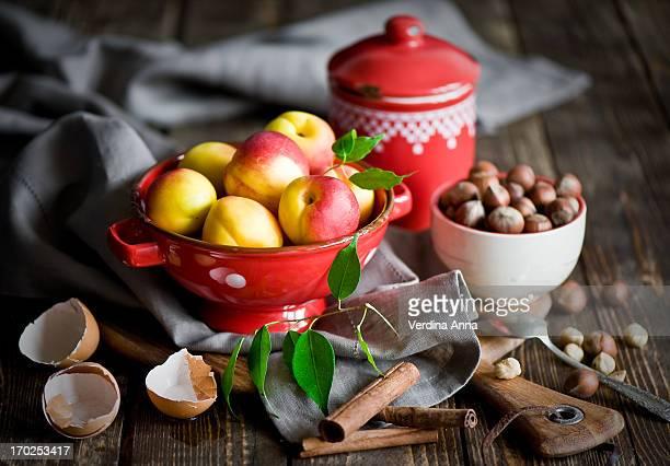 baking with peaches - anna verdina stock photos and pictures