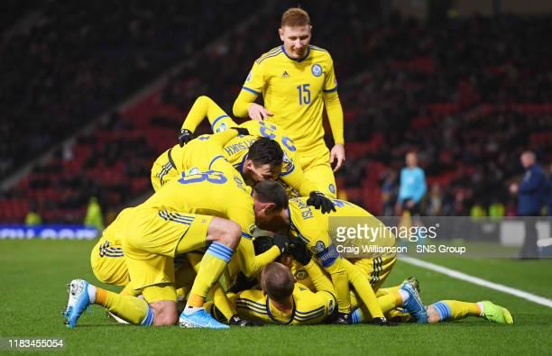 Baktiyor Zainutdinov celebrates his goal with teammates during the UEFA European Championship Qualifier between Scotland and Kazakhstan at Hampden...