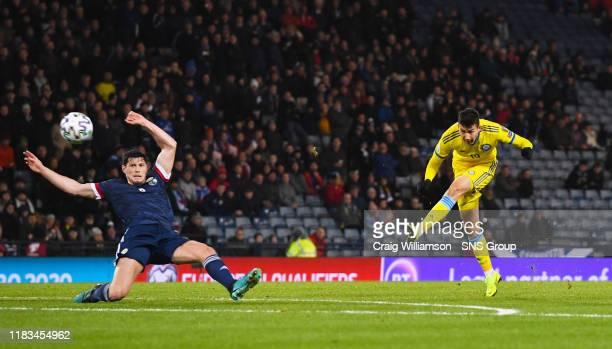 Baktiyor Zainutdinov gives Kazakhstan the lead during the UEFA European Championship Qualifier between Scotland and Kazakhstan at Hampden Park on...