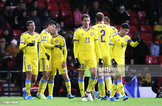 Baktiyor Zainutdinov of Kazakhstan celebrates with his team mates after scoring his team's first goal during the UEFA Euro 2020 qualifier between...