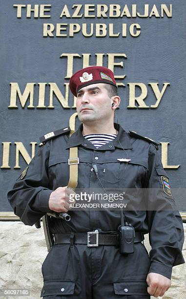 An Azeri policeman guards the entrance to the Interior Ministry in downtown Baku 05 November 2005 The former Soviet republic of Azerbaijan goes to...